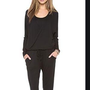 Feel the Piece Black jumpsuit.  Size M/L